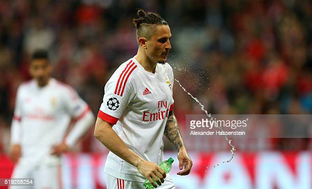 Ljubomir Fejsa of Benfica squirts water from his mouth during the UEFA Champions League quarter final first leg match between FC Bayern Muenchen and...