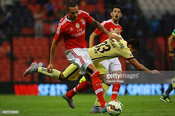 Ljubomir Fejsa of Benfica steals the ball from Bryan Colula of America during a match between America and Benfica as part of the International...