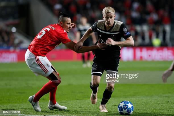 Ljubomir Fejsa of Benfica vies for the ball with Donny van de Beek of Ajax during Champions League 2018/19 match between SL Benfica vs Ajax Amsterdam...
