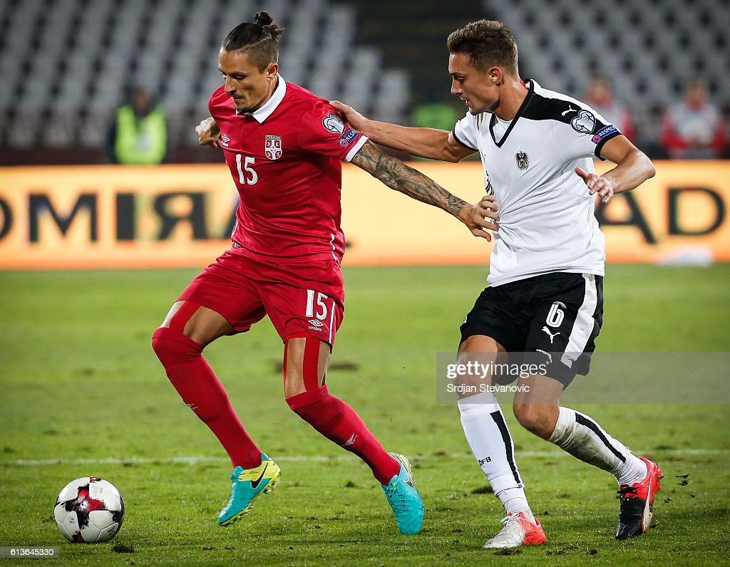 Ljubomir Fejsa of Serbia in action against Stefan Ilsanker (R) of Austria during the FIFA 2018 World Cup Qualifier between Serbia and Austria at stadium Rajko Mitic on October 9, 2016 in Belgrade, .