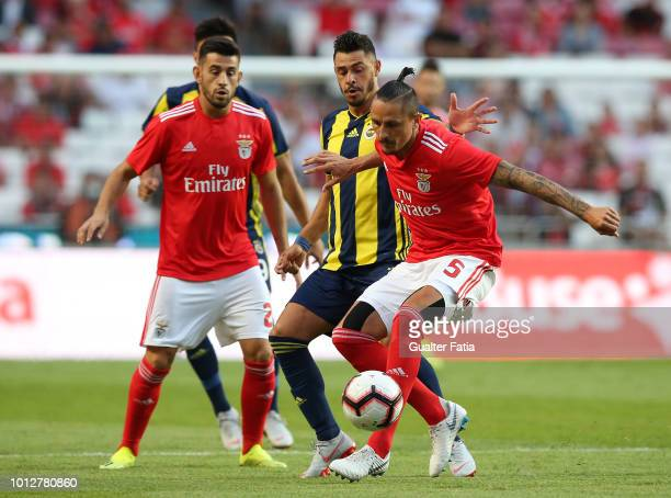Ljubomir Fejsa of SL Benfica fights for the ball with Giuliano of Fenerbache SK during the UEFA Champions League Qualifier match between SL Benfica...