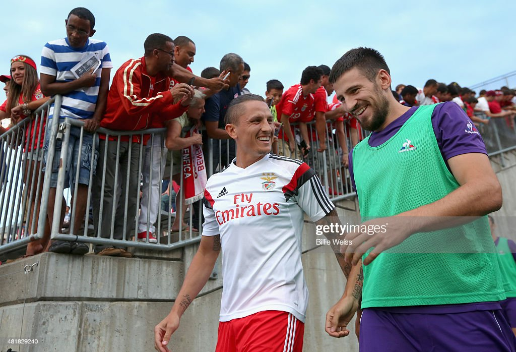 Ljubomir Fejsa of SL Benfica (left) reacts with a member of ACF Fiorentina as they walk onto the field before an International Champions Cup 2015 match at Rentschler Field on July 24, 2015 in East Hartford, Connecticut.