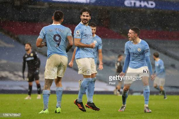 İlkay Gundogan of Manchester City celebrates with Gabriel Jesus and Phil Foden after scoring their team's second goal during the Premier League match...