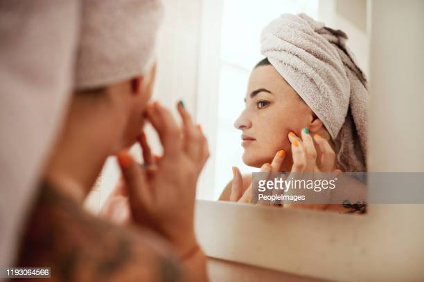 i'll find those zits and i'll zap them - caucasian appearance stock pictures, royalty-free photos & images