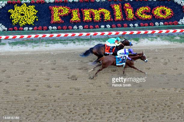 I'll Have Another ridden by Mario Gutierrez beats Bodemeister ridden by Mike E Smith at the finish line to win the 137th running of the Preakness...