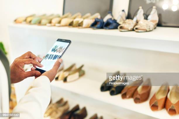 i'll have to get a fashionista's opinion - shoe store stock pictures, royalty-free photos & images