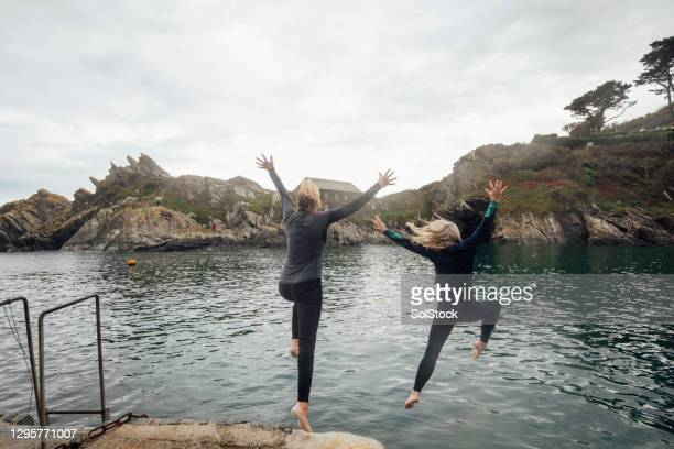 i'll jump if you jump - diving into water stock pictures, royalty-free photos & images