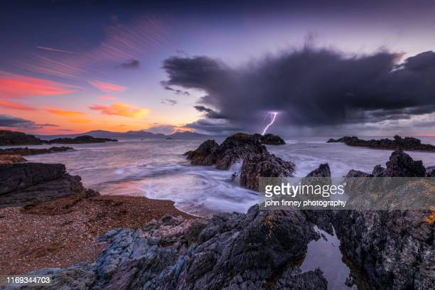 llanddwyn island beach at sunset with a lightning strike, bangor, caernarfon,, anglesey, united kingdom - wales stock pictures, royalty-free photos & images
