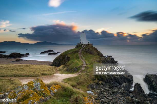 llanddwyn island lighthouse, anglesey, wales, uk - menai straits stock pictures, royalty-free photos & images