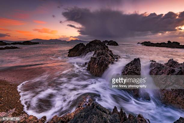 llanddwyn island rocks and sea, anglesey, wales, uk - menai straits stock pictures, royalty-free photos & images