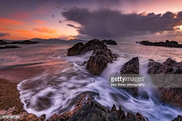 Llanddwyn Island rocks and sea, Anglesey, Wales, UK