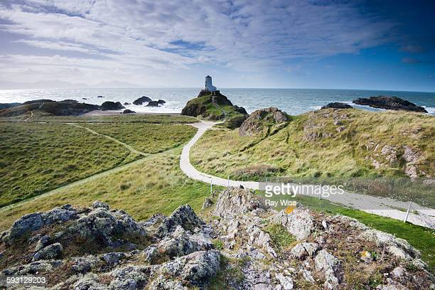 llanddwyn lighthouse and path - menai straits stock pictures, royalty-free photos & images