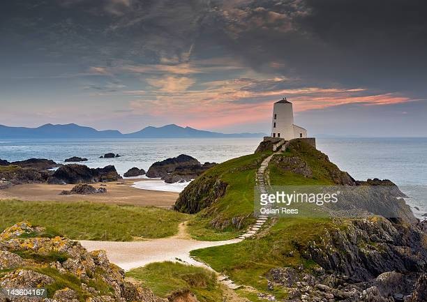 llanddwyn lighthouse - snowdonia stock photos and pictures