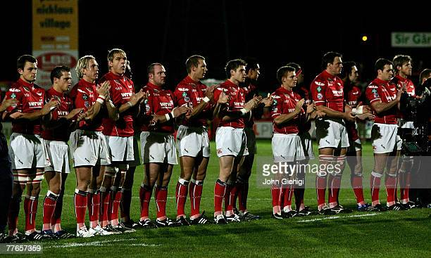Llanelli players pay respect to the late Ray Gravell before the EDF Energy Cup game between Llanelli Scarlets and Leeds Carnegie at Stradey Park on...