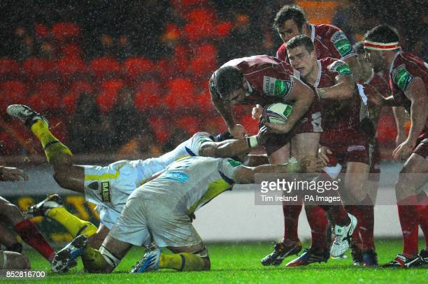 Llanelli Scarlets' Rob McCusker is tackled by ASM Clermont Auvergne's Damien Chouly and Thomas Domingo during the Heineken Cup Pool Four match at...