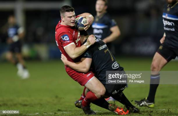 Llanelli Scarlets Scott Williams is tackled Bath's Sam Underhill by during the Champions Cup match at the Recreation Ground Bath