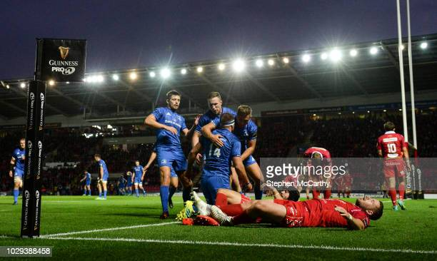 Llanelli , United Kingdom - 8 September 2018; Fergus McFadden is congratulated by his Leinster team-mates Ross Byrne, left, Rory O'Loughlin and...