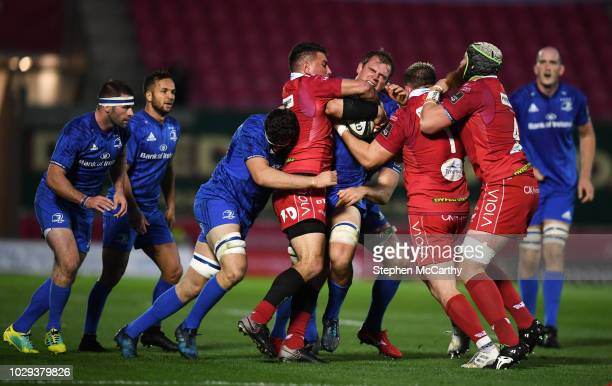 Llanelli , United Kingdom - 8 September 2018; Rhys Ruddock of Leinster is tackled by Scarlets players, from left, Kieron Fonotia, Rob Evans and Jake...