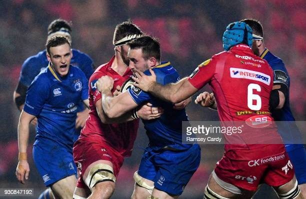Llanelli United Kingdom 9 March 2018 Jack Conan of Leinster is tackled by Tadhg Beirne of Scarlets during the Guinness PRO14 Round 17 match between...