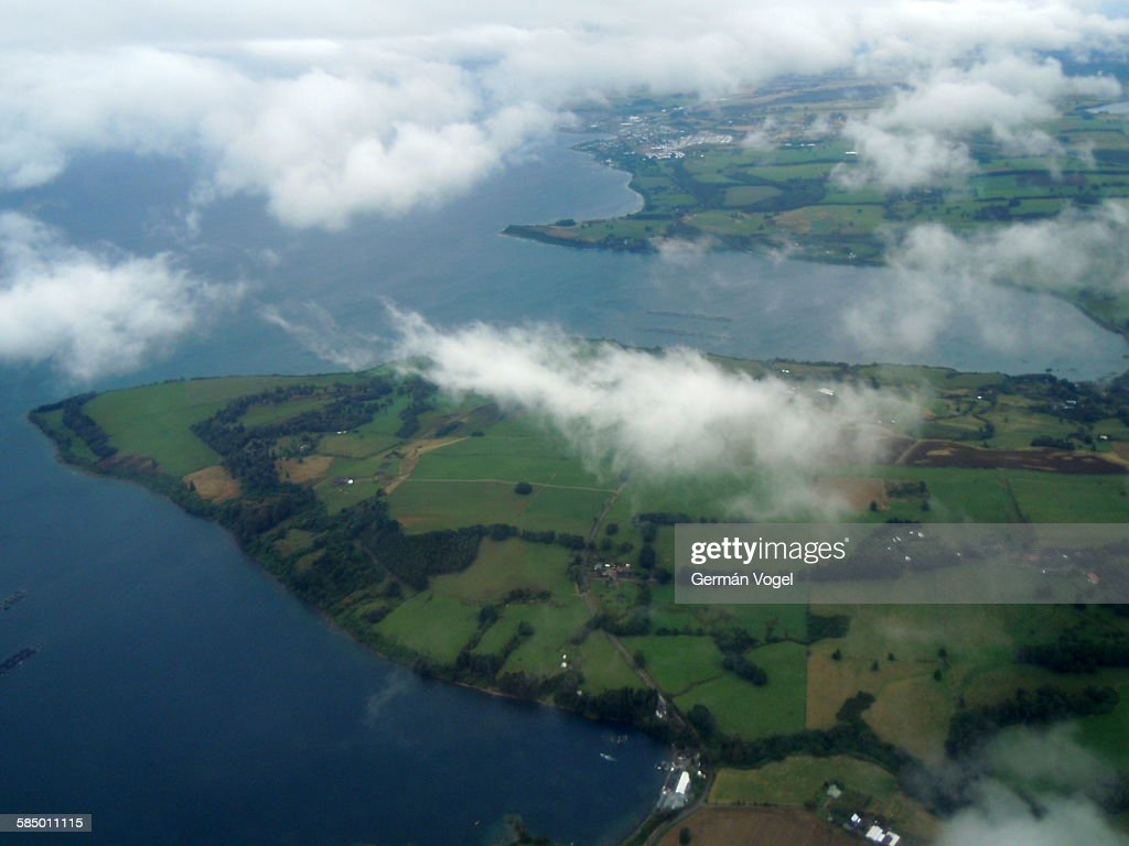 Llanquihue lake, Chile, aerial view through clouds : Stock Photo
