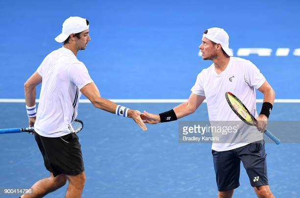 Lleyton Hewitt and Jordan Thompson of Australia celebrate in their doubles match against Grigor Dimitrov of Bulgaria and Ryan Harrison of USA during...