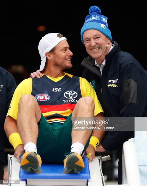 Lleyton Hewitt and Neale Daniher look on as part of the Big Freeze 3 during the 2017 AFL round 12 match between the Melbourne Demons and the...