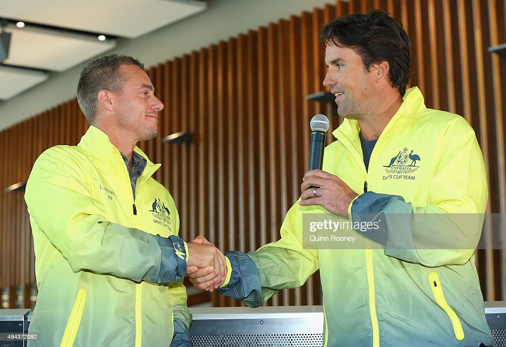 Lleyton Hewitt and Pat Rafter shake hands during a Tennis Australia media opportunity at Melbourne Park at Melbourne Park on October 27, 2015 in Melbourne, Australia. Hewitt was today named as Australia's Davis Cup Captain.