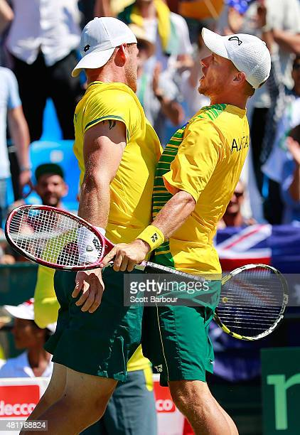 Lleyton Hewitt and Sam Groth of Australia bump chests as they celebrate winning a game as Sam Groth and Lleyton Hewitt of Australia play Andrey...