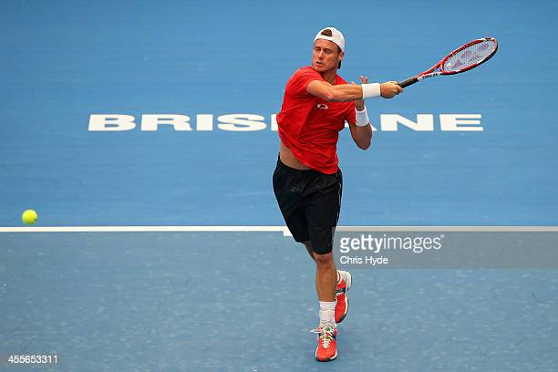 Lleyton Hewitt hits a forehand during a practice session at Pat Rafter Arena on December 13 2013 in Brisbane Australia