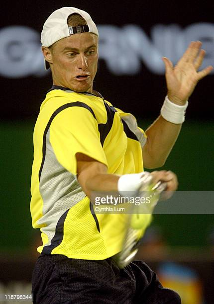 Lleyton Hewitt hits a forehand Unseeded Juan Ignacio Chela upsets third seed Lleyton Hewitt 64 64 67 63 in the second round of the Australian Open...