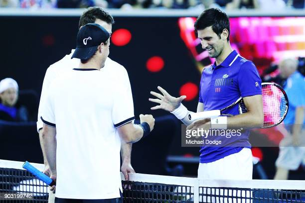 Lleyton Hewitt of Australia and Novak Djokovic of Serbia complete a game of paper scissors rock during the Tie Break Tens ahead of the 2018...