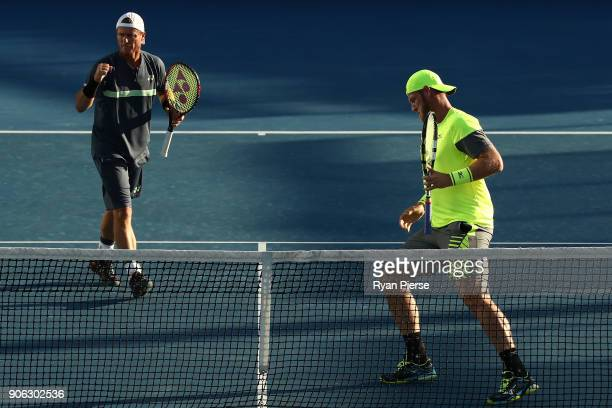 Lleyton Hewitt of Australia and Sam Groth of Australia compete in their first round men's doubles match against Denis Istomin of Uzbekistan and...