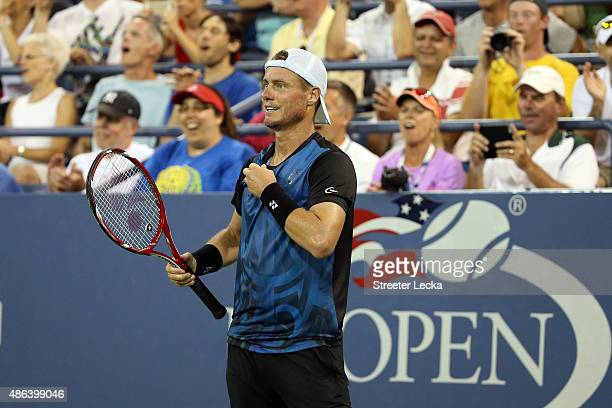 Lleyton Hewitt of Australia celebrates a point against Bernard Tomic of Australia during their Men's Singles Second Round match on Day Four of the...