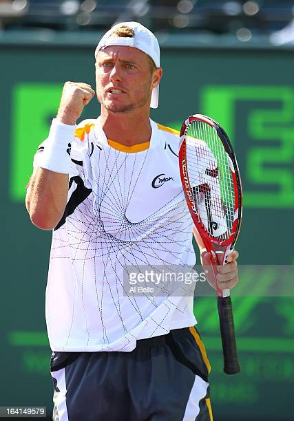 Lleyton Hewitt of Australia celebrates a point against Joao Sousa of Portugal during Day 3 of the Sony Open at at the Crandon Park Tennis Center on...