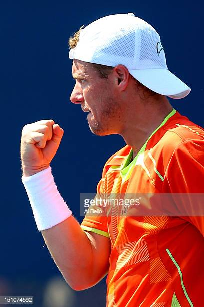 Lleyton Hewitt of Australia celebrates after winning a set from Gilles Muller of Luxembourg in their men's singles second round match on Day Five of...