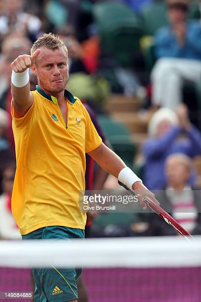 Lleyton Hewitt of Australia celebrates defeating Marin Cilic of Croatia in the second round of Men's Singles Tennis on Day 4 of the London 2012...