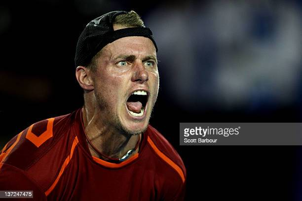 Lleyton Hewitt of Australia celebrates match point during his first round match against CedrikMarcel Stebe of Germany during day two of the 2012...