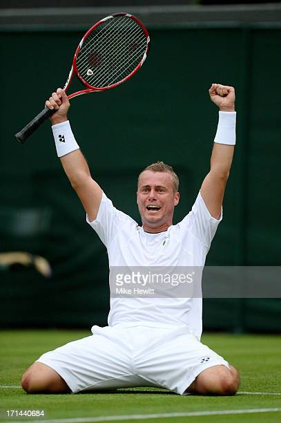 Lleyton Hewitt of Australia celebrates match point during his Gentlemen's Singles first round match against Stanislas Wawrinka of Switzerland on day...