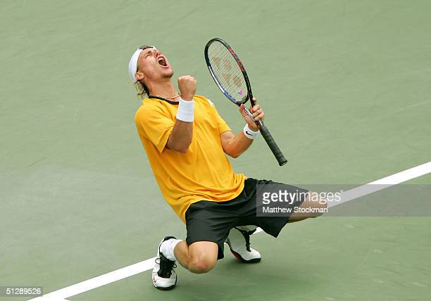 Lleyton Hewitt of Australia celebrates match point over Joachim Johansson of Sweden in the men's semi-final match during the US Open September 11,...
