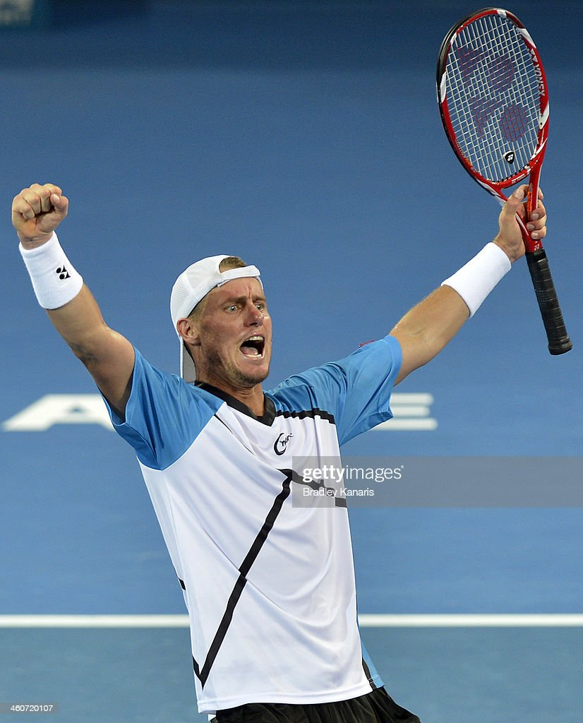 Lleyton Hewitt of Australia celebrates victory after his Mens finals match against Roger Federer of Switzerland during day eight of the 2014 Brisbane International at Queensland Tennis Centre on January 5, 2014 in Brisbane, Australia.