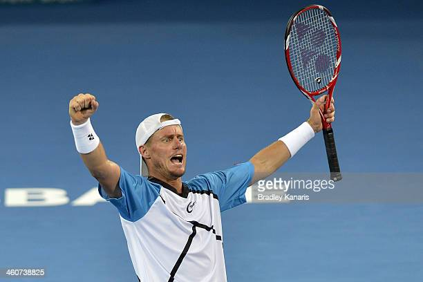 Lleyton Hewitt of Australia celebrates victory after winning his Mens finals match against Roger Federer of Switzerland during day eight of the 2014...
