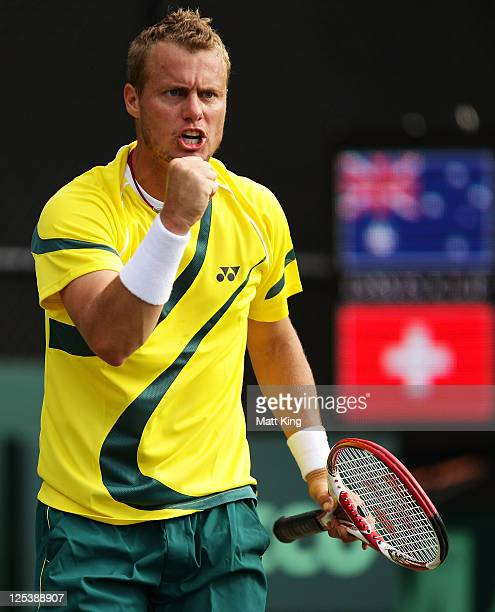 Lleyton Hewitt of Australia celebrates winning a point being partnered by Chris Guccione in their Davis Cup World Group Playoff Tie match against...