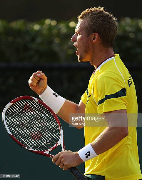 Lleyton Hewitt of Australia celebrates winning a point in his Davis Cup World Group Playoff Tie match against Stanislas Wawrinka of Switzerland at...