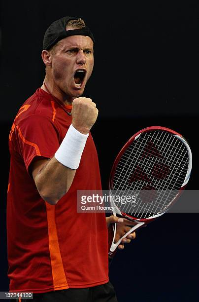 Lleyton Hewitt of Australia celebrates winning a point in his first round match against CedrikMarcel Stebe of Germany during day two of the 2012...