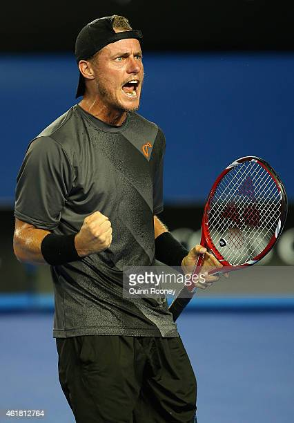 Lleyton Hewitt of Australia celebrates winning his first round match against Ze Zhang of China during day two of the 2015 Australian Open at...