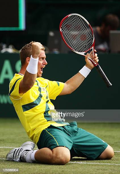 Lleyton Hewitt of Australia celebrates winning match point being partnered by Chris Guccione in their Davis Cup World Group Playoff Tie match against...