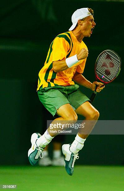 Lleyton Hewitt of Australia celebrates winning the first reverse singles match over Roger Federer of Switzerland during the Davis Cup Semi Final...