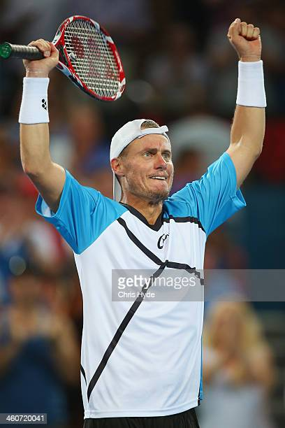 Lleyton Hewitt of Australia celebrates winning the mens final match against Roger Federer of Switzerland during day eight of the 2014 Brisbane...
