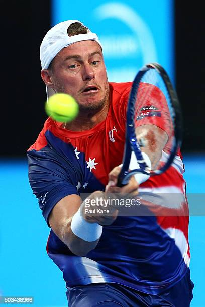Lleyton Hewitt of Australia Gold plays a backhand to to Jack Sock of the United States in his singles match during day three of the 2016 Hopman Cup...