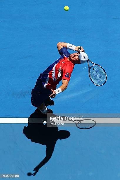Lleyton Hewitt of Australia Gold serves to Alexandr Dolgopolov of the Ukraine in the mens singles match during day five of the 2016 Hopman Cup at...